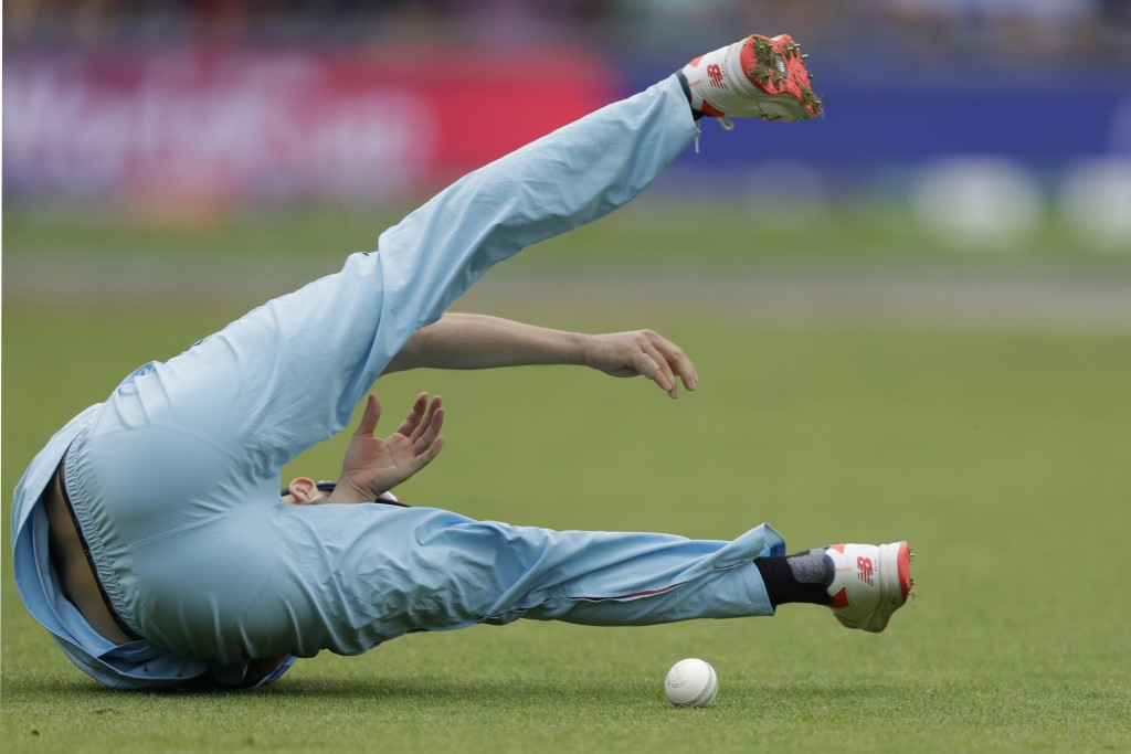 England's Mark Wood fails to hold a catch that would have taken the wicket of West Indies' Chris Gayle during the Cricket World Cup match between Engl