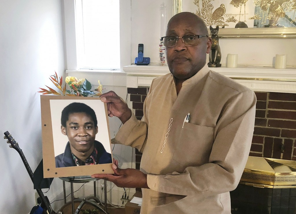 FILE - In this Sept. 5, 2018 file photo, Dia Khafra, father of Askia Khafra, holds a photo of his son in his Silver Springs, Md., home. A judge has re