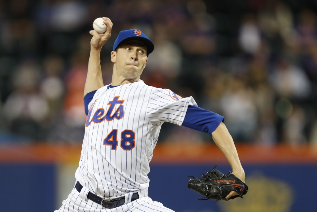 New York Mets starting pitcher Jacob deGrom winds up during the second inning of the team's baseball game against the St. Louis Cardinals, Thursday, J