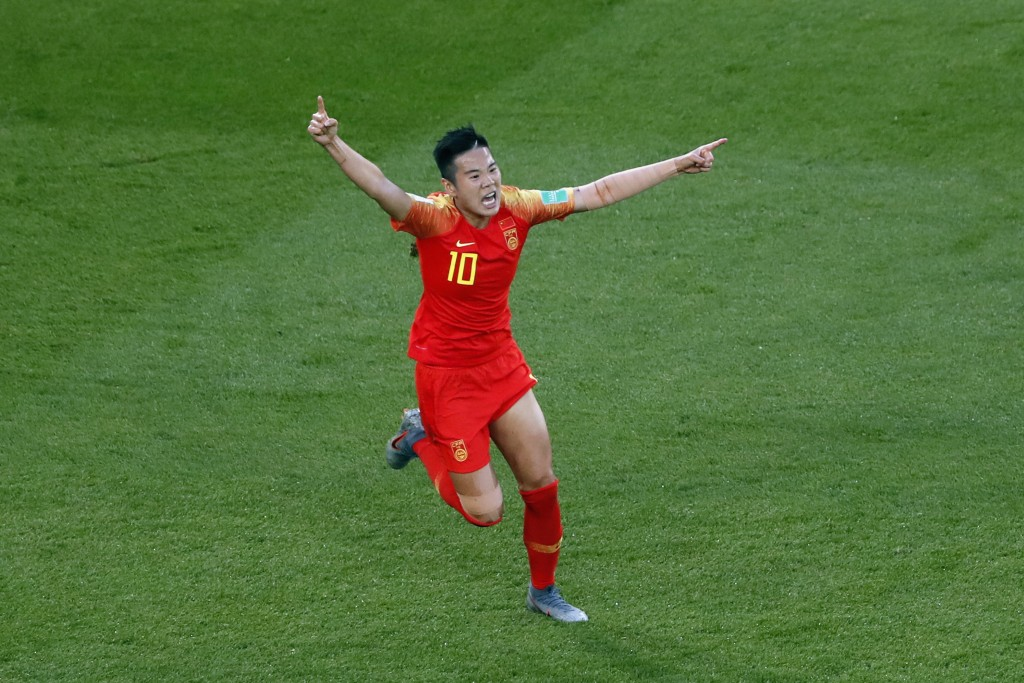 China's Li Ying, right, celebrates after scoring her side's opening goal during the Women's World Cup Group B soccer match between China and South Afr