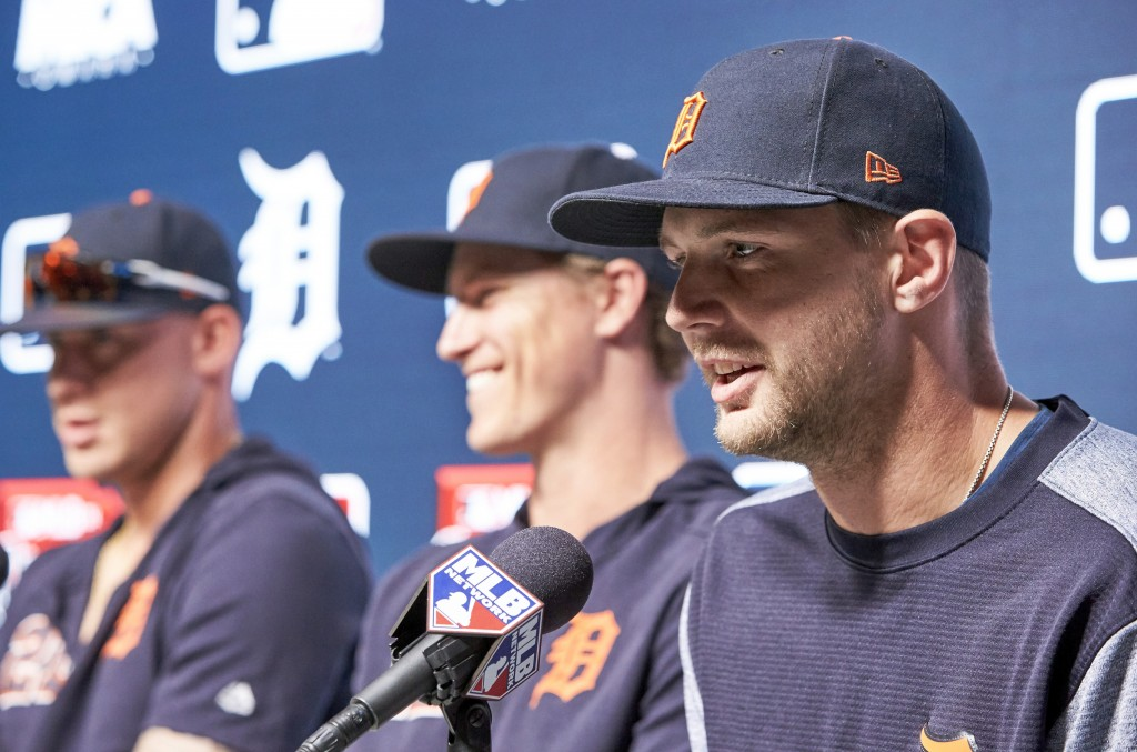 Detroit Tigers' Grayson Greiner, right, talks during a news conference with teammates Brandon Dixon and JaCoby Jones, left, ahead of a baseball game b...