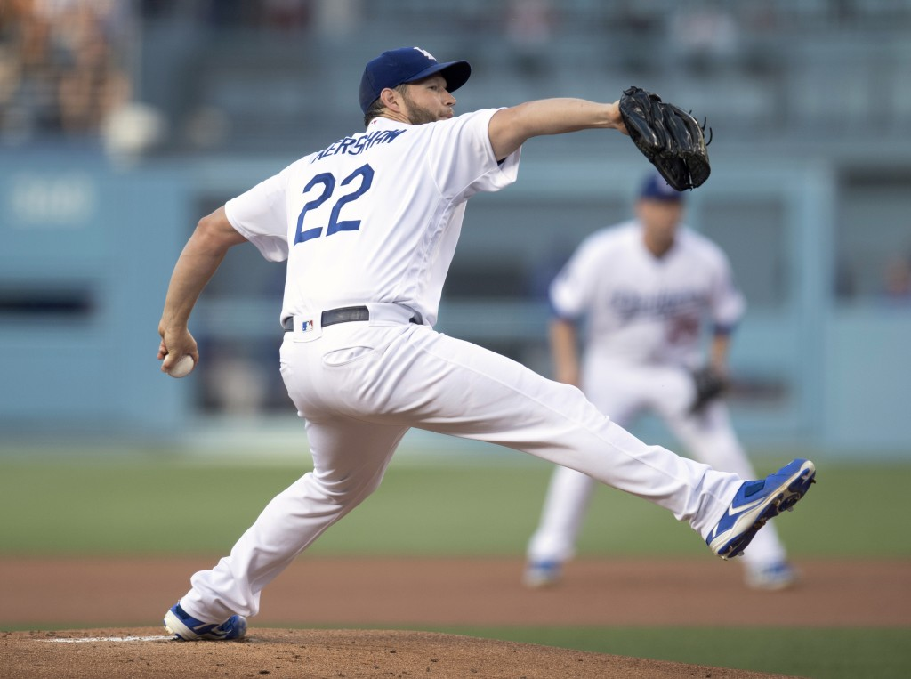 Los Angeles Dodgers starting pitcher Clayton Kershaw throws during the first inning of the team's baseball game against the Chicago Cubs in Los Angele