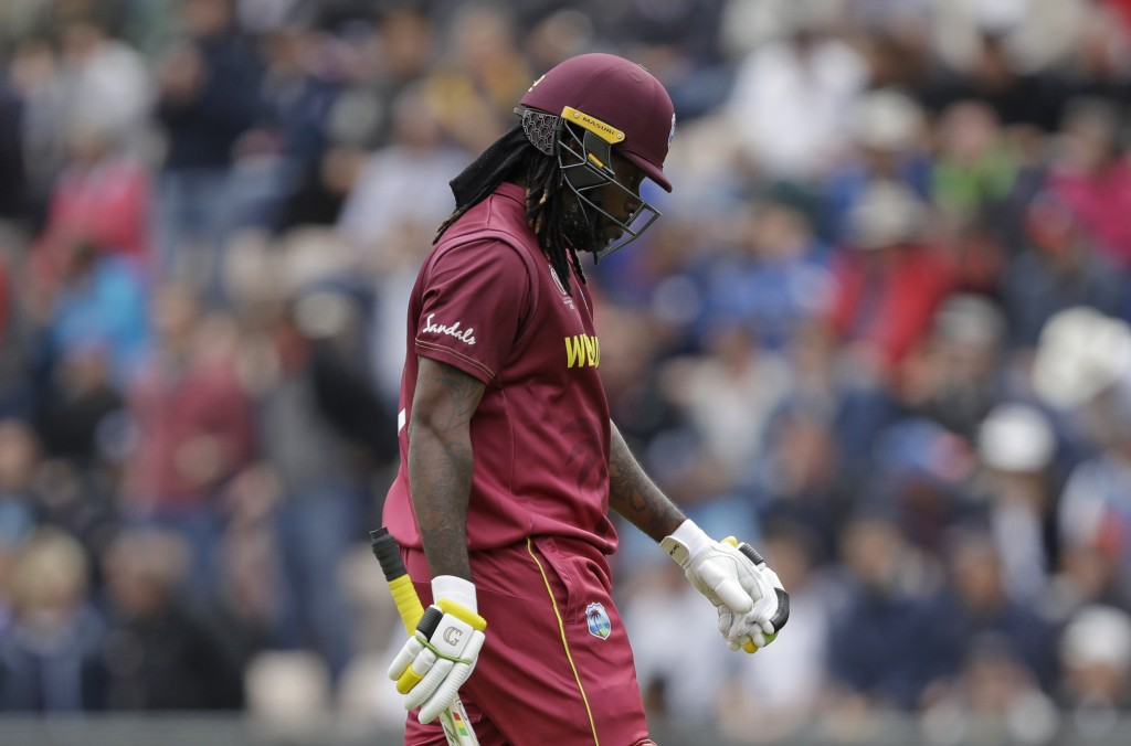 West Indies' Chris Gayle walks off the field of play after losing his wicket from the bowling of England's Liam Plunkett during the Cricket World Cup ...