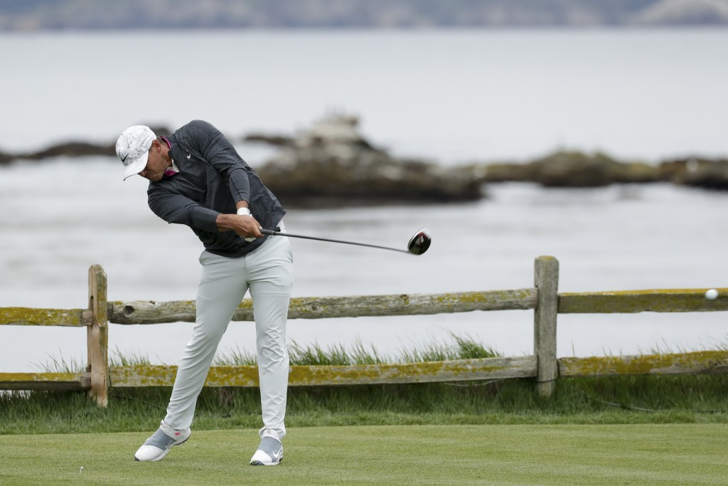 Brooks Koepka hits his tee shot on the 18th hole during the second round of the U.S. Open Championship golf tournament Friday, June 14, 2019, in Pebbl