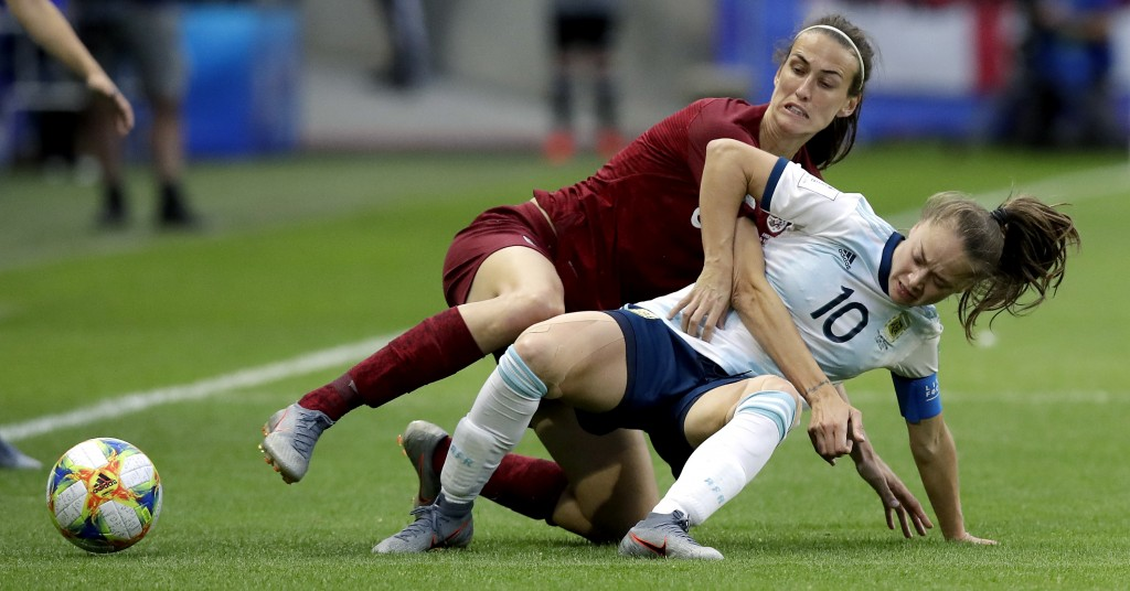 Argentina's Estefania Banini, left, and England's Jill Scott, right, challenge for the ball during the Women's World Cup Group D soccer match between