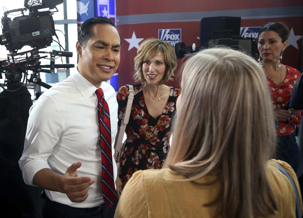 Democratic presidential candidate Julian Castro speaks to members in the crowd after a FOX News Channel town hall event, Thursday, June 13, 2019, in T