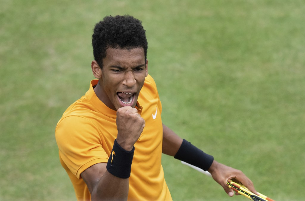 Felix Auger-Aliassime, of Canada, reacts during the quarterfinals of the Stuttgart Open tennis tournament against Dustin Brown of Germany,, Friday, Ju