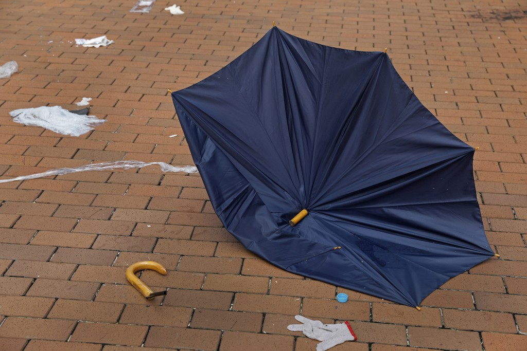 In this Friday, June 14, 2019, photo, a broken umbrella left in the aftermath of Wednesday's violent protest against proposed amendments to an extradi...