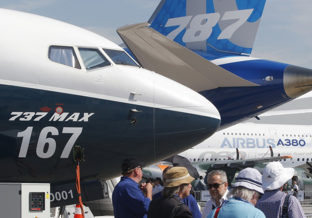 FILE - In this June 20, 2017, file photo Boeing planes displayed at Paris Air Show, in Le Bourget, east of Paris, France. Uncertainty over a Boeing je