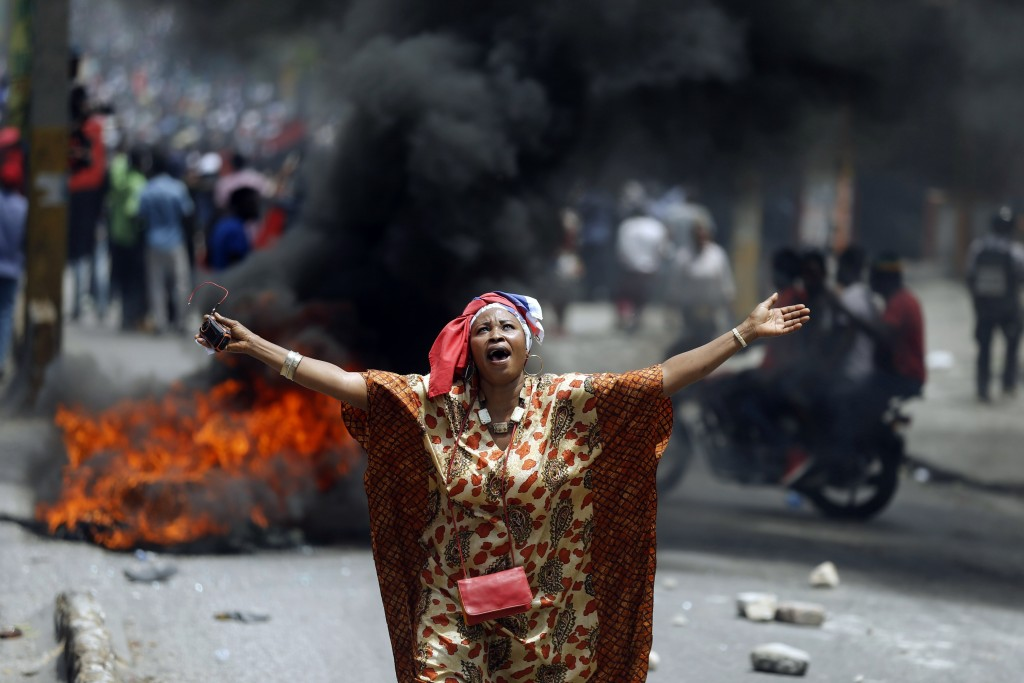 A demonstrator yells anti-government slogans in Port-au-Prince, Haiti, on Sunday, June 9, 2019. Protesters denouncing corruption paralyzed much of the...