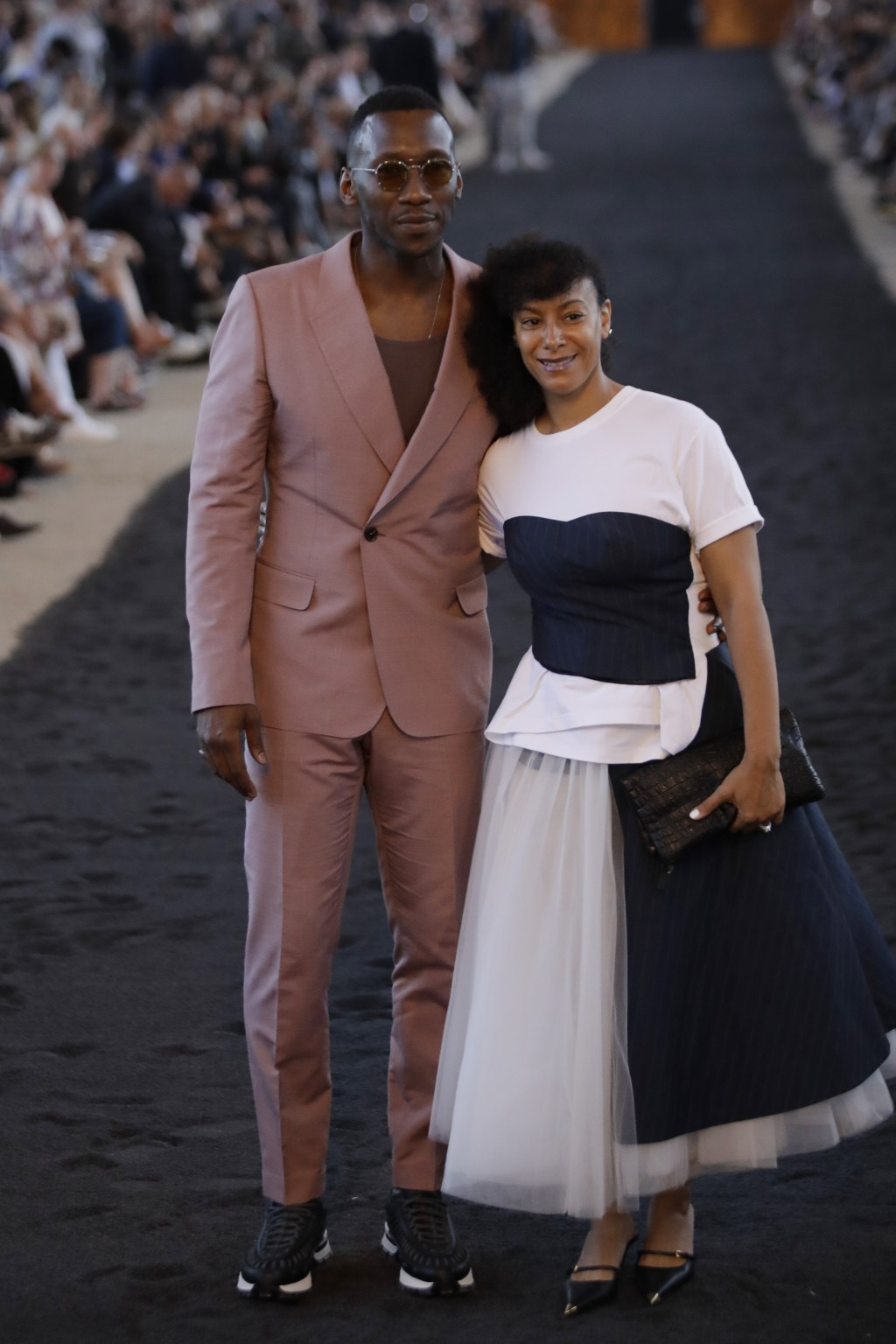 Actor Mahershala Ali, left, and his wife Amatus Sami-Karim arrive ahead of the Ermenegildo Zegna men's Spring-Summer 2020 collection, unveiled during