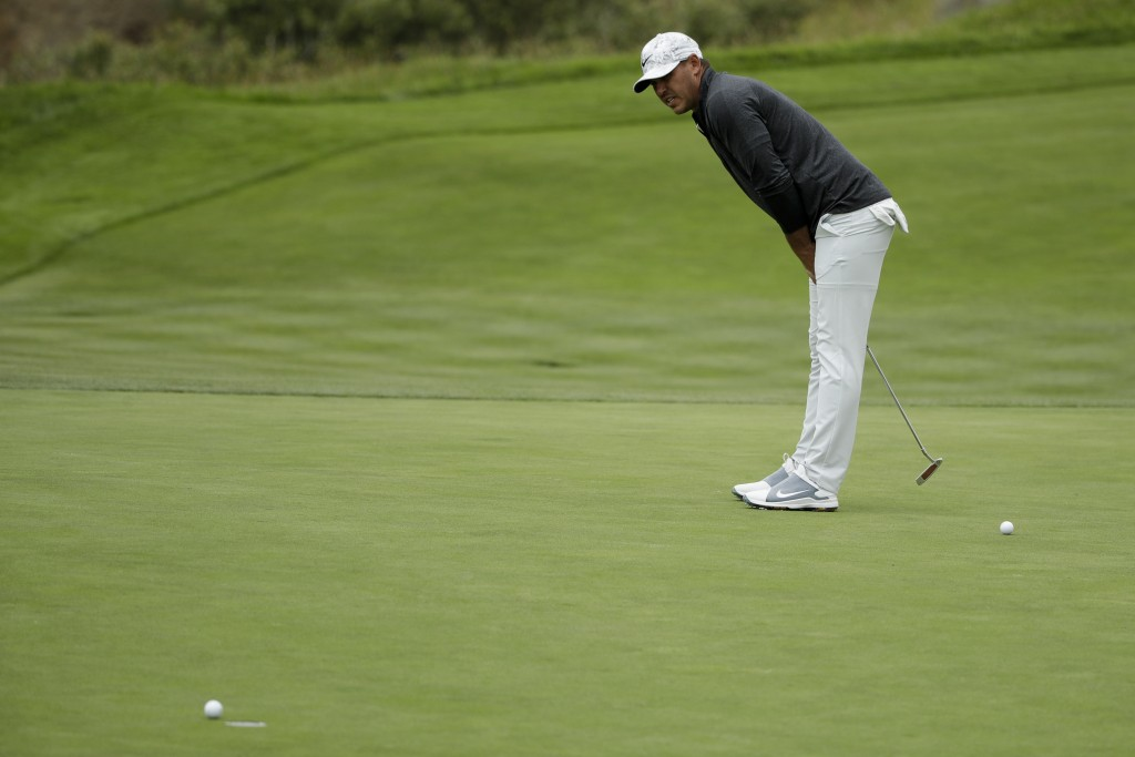 Brooks Koepka reacts after missing a putt on the eighth hole during the second round of the U.S. Open Championship golf tournament Friday, June 14, 20