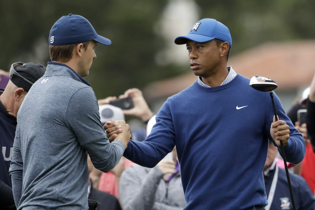Jordan Spieth, left, and Tiger Woods shake hands on the 10th hole during the second round of the U.S. Open Championship golf tournament Friday, June 1