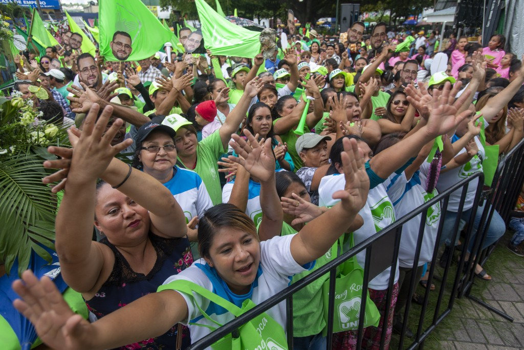 Supporters cheer for Sandra Torres, presidential candidate of the National Unity of Hope party, UNE, during her closing campaign rally prior to Sunday