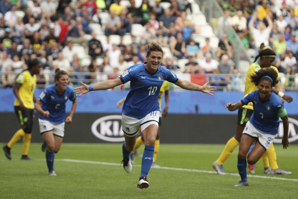 Italy's Cristiana Girelli, center, celebrates after scoring her side's second goal during the Women's World Cup Group C soccer match between Italy and
