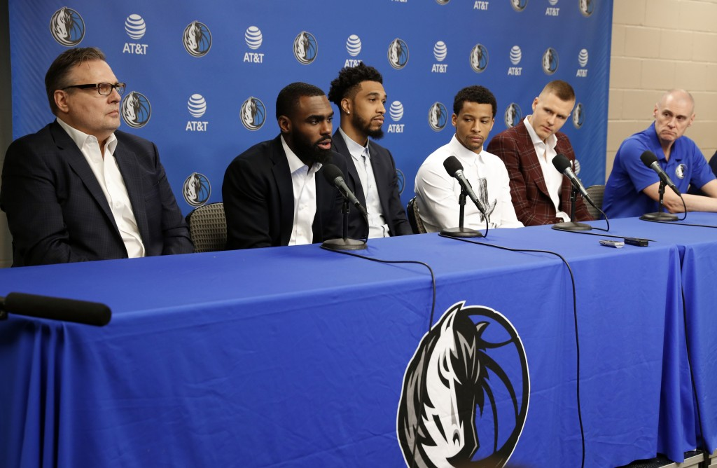 FILE - In this Feb. 4, 2019, file photo, Dallas Mavericks President of Basketball Operations, Donnie Nelson, from left, Tim Hardaway Jr., Courtney Lee