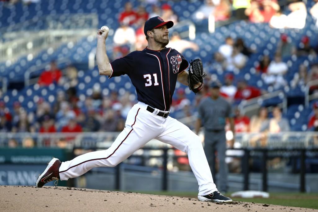 Washington Nationals starting pitcher Max Scherzer throws to an Arizona Diamondbacks batter during the second inning of a baseball game Friday, June 1...