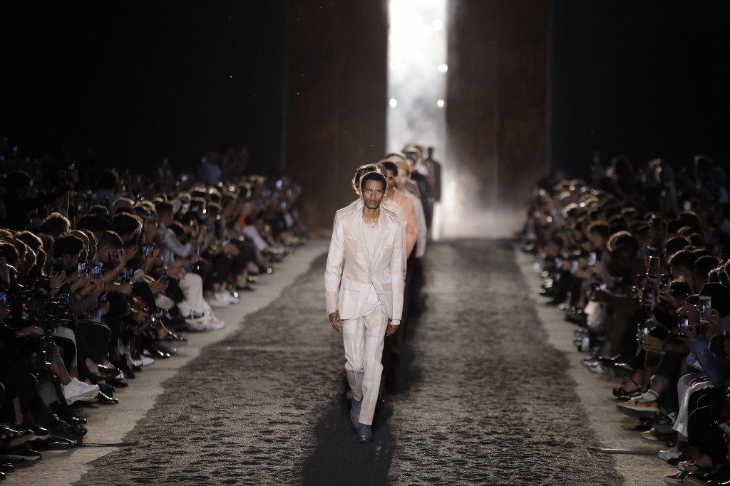 Models wear creations as part of the Ermenegildo Zegna men's Spring-Summer 2020 collection, unveiled during the fashion week, in Milan, Italy, Friday,