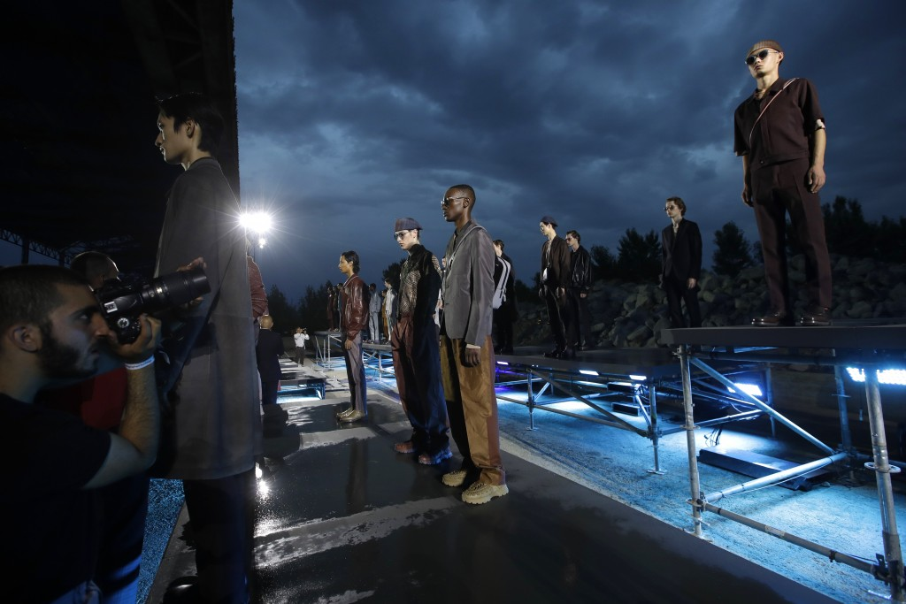 Models are photographered wearing creations as part of the Ermenegildo Zegna men's Spring-Summer 2020 collection, unveiled during the fashion week, in