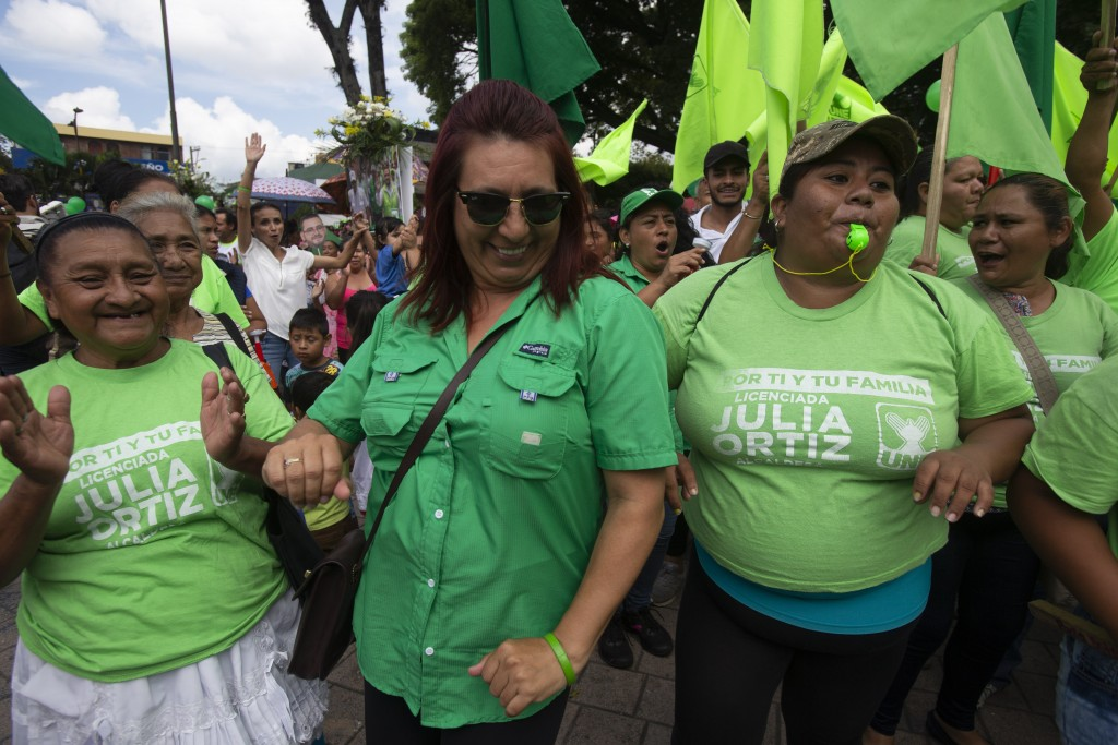 Supporters of Sandra Torres, presidential candidate of the National Unity of Hope party, UNE, dance during her closing campaign rally prior to Sunday'