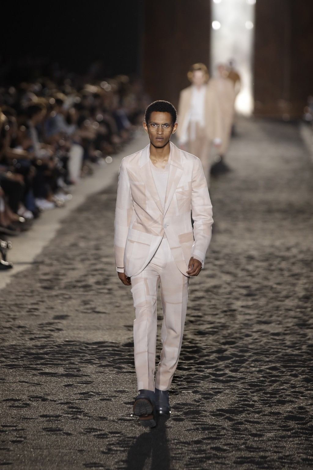 A model wears a creation as part of the Ermenegildo Zegna men's Spring-Summer 2020 collection, unveiled during the fashion week, in Milan, Italy, Frid