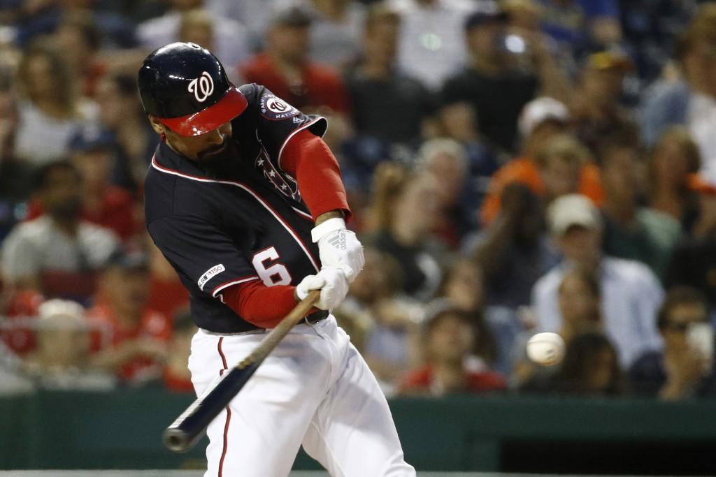 Washington Nationals' Anthony Rendon hits a solo home run during the sixth inning of a baseball game against the Arizona Diamondbacks, Friday, June 14...