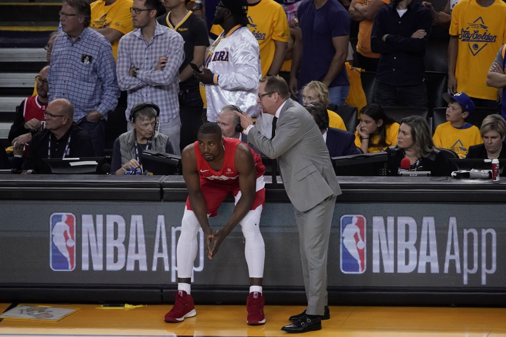 Toronto Raptors head coach Nick Nurse talks with center Serge Ibaka during the first half of Game 6 of basketball's NBA Finals against the Golden Stat
