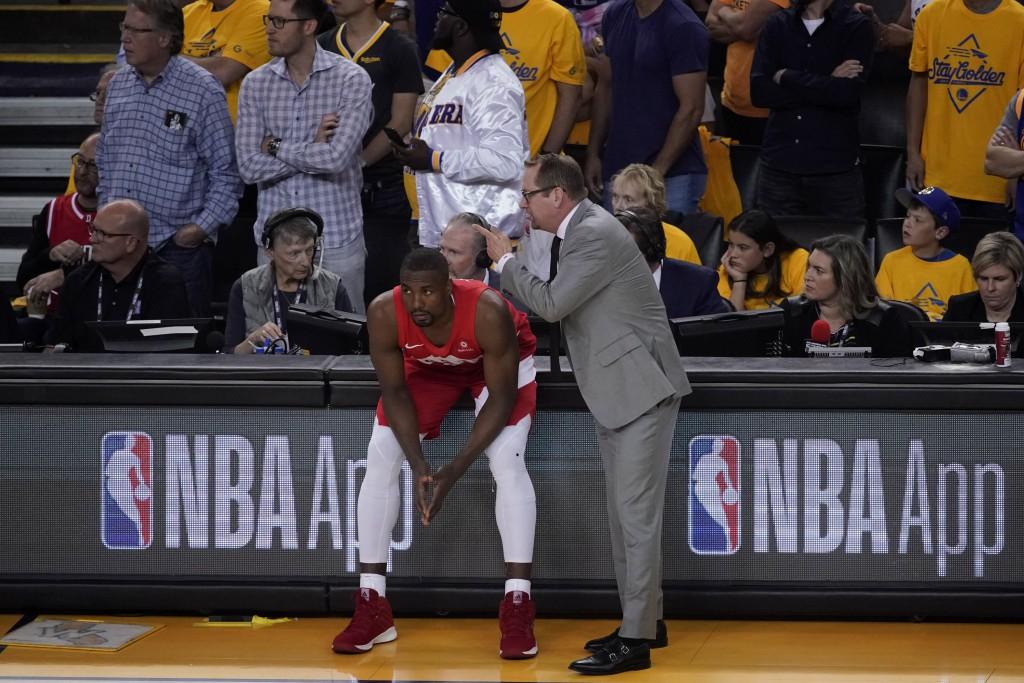 Toronto Raptors head coach Nick Nurse talks with c...