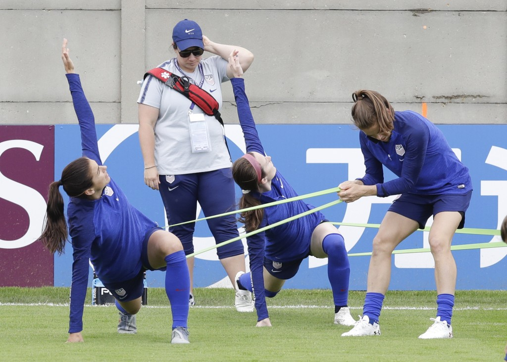 From left United States players Alex Morgan, Rose Lavelle and Kelley O'Hara warm up during a training session at the Terrain d'Honneur Lucien Choine s...