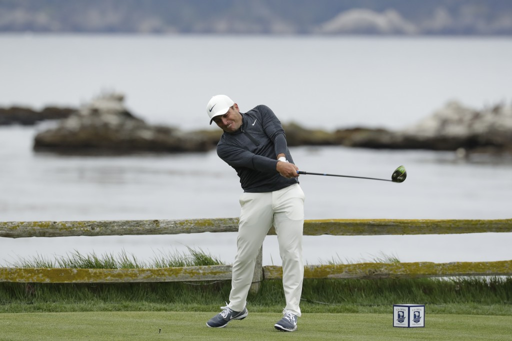 Francesco Molinari, of Italy, hits his tee shot on the 18th hole during the second round of the U.S. Open Championship golf tournament Friday, June 14