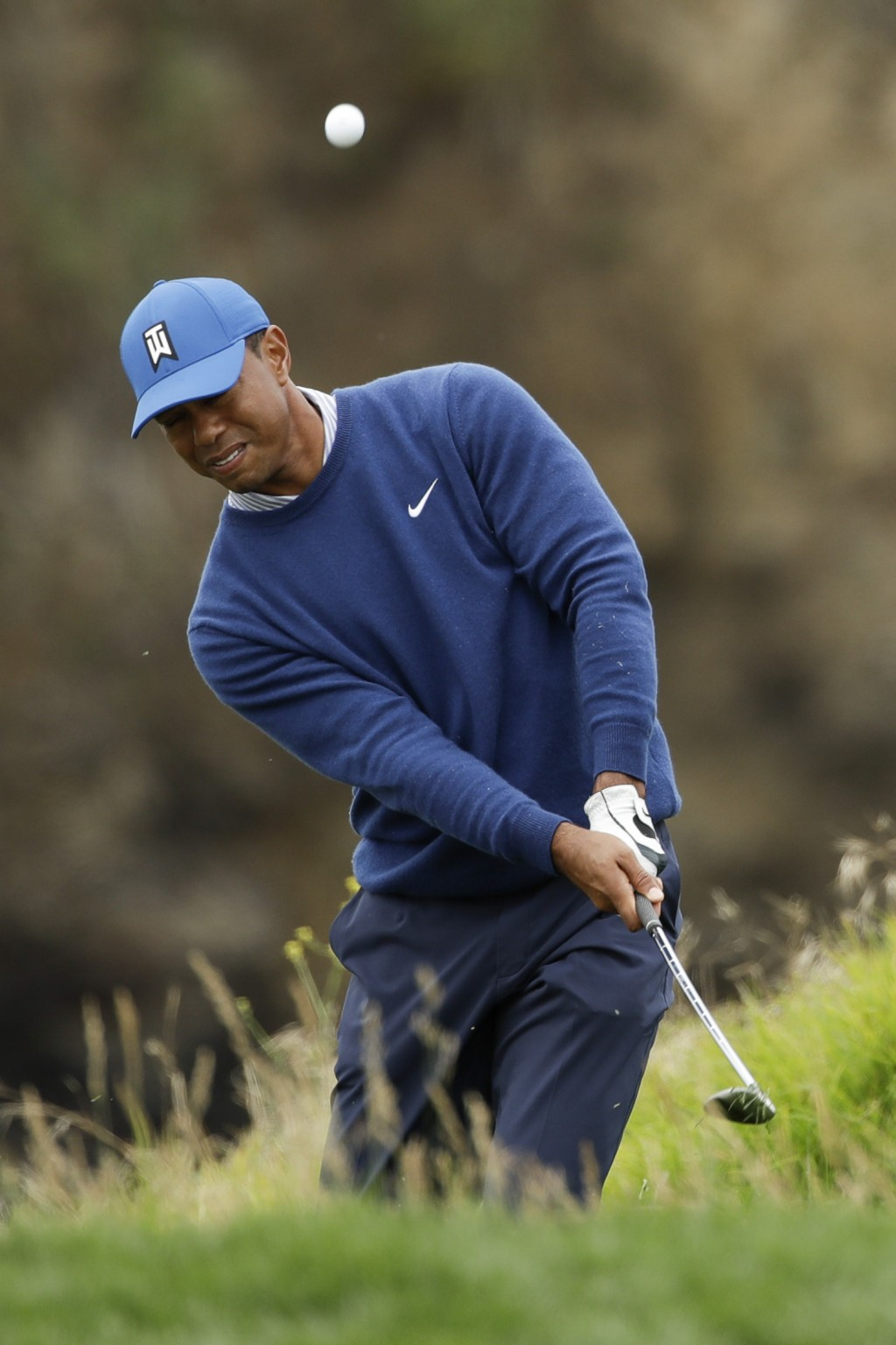 Tiger Woods hits from the rough on the eighth hole during the second round of the U.S. Open Championship golf tournament Friday, June 14, 2019, in Peb