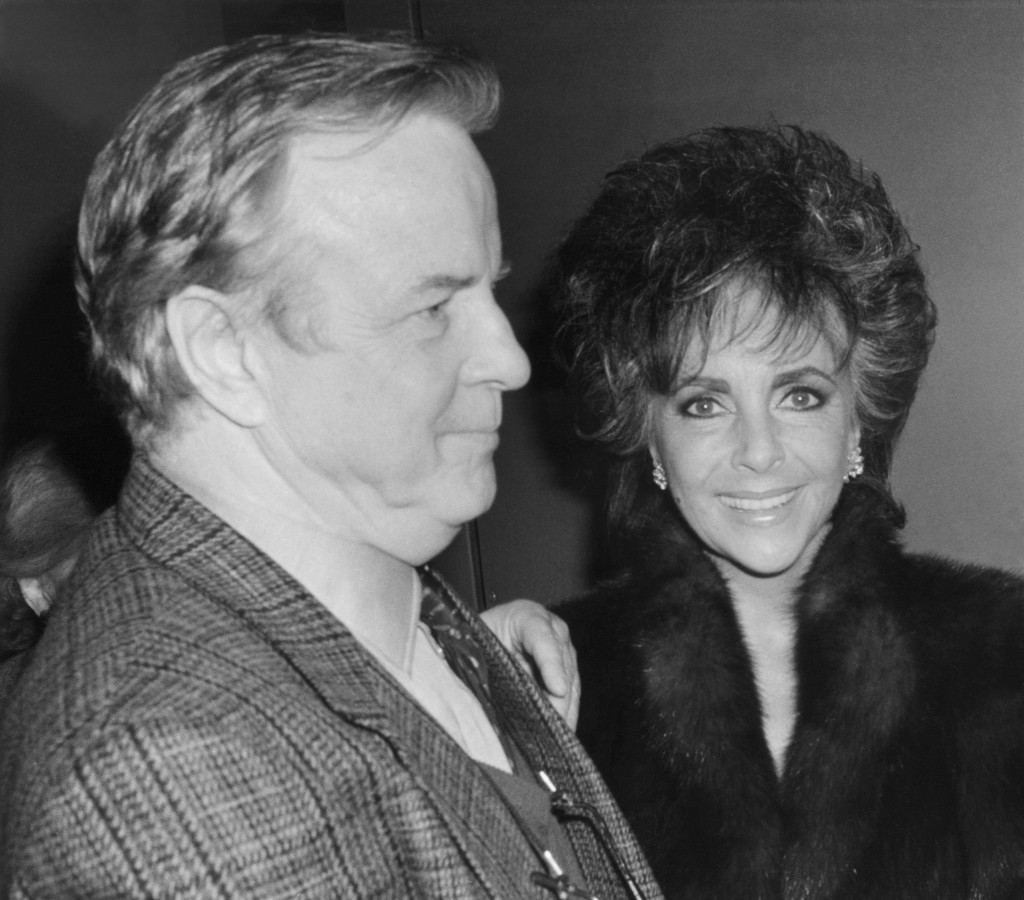 "FILE - In this April 10, 1987 file photo,Franco Zefferelli, producer and set designer of the Puccini opera ""Turandot,"", escorts Liz Taylor to her limo..."