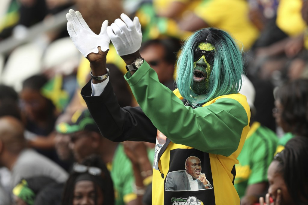 A Jamaican fan cheers during the Women's World Cup Group C soccer match between Italy and Jamaica at the Stade Auguste-Delaune in Reims, France, Frida