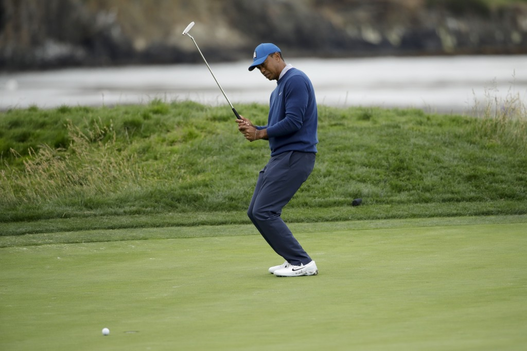 Tiger Woods reacts after missing a putt on the 17th hole during the second round of the U.S. Open golf tournament Friday, June 14, 2019, in Pebble Bea