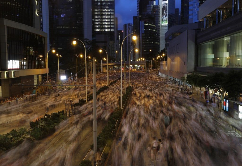 Protesters march against proposed amendments to an extradition law in Hong Kong Sunday, June 9, 2019. The unpopular bills would allow Hong Kong suspec...