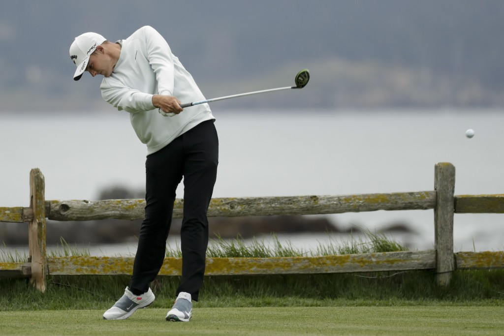 Aaron Wise hits his tee shot on the 18th hole during the second round of the U.S. Open Championship golf tournament Friday, June 14, 2019, in Pebble B