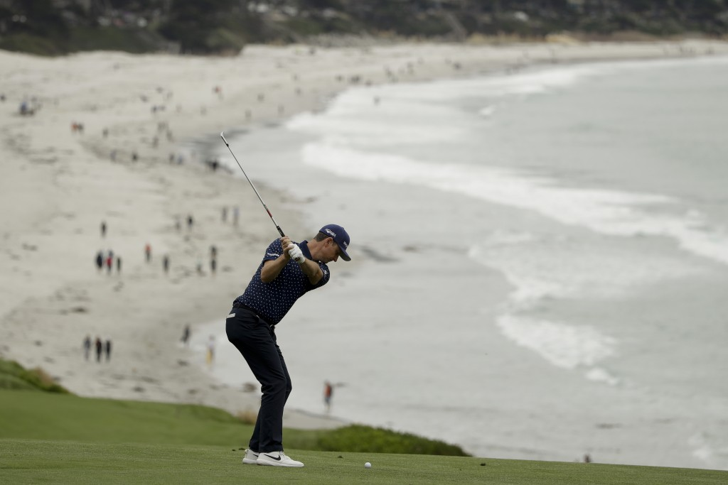 Justin Rose, of England, hits from the fairway on the ninth hole during the second round of the U.S. Open golf tournament Friday, June 14, 2019, in Pe
