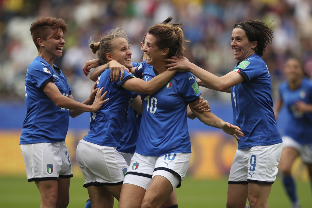 Italy's Cristiana Girelli, second right, celebrates after scoring her side's third goal during the Women's World Cup Group C soccer match between Ital