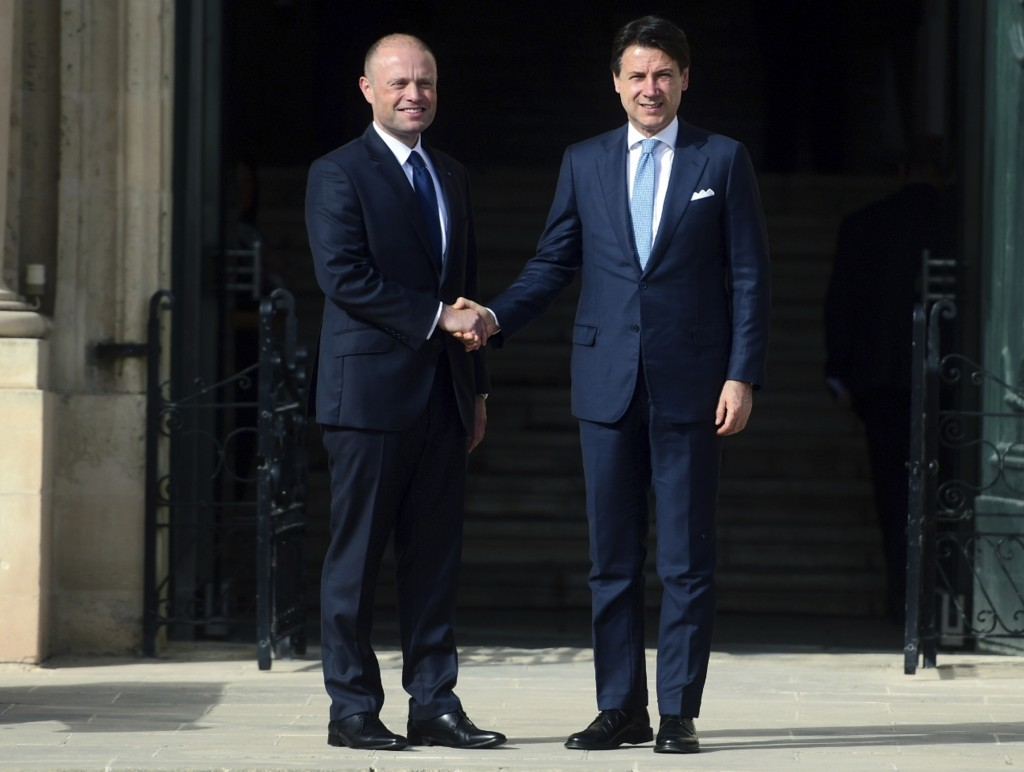 Italian Premier Giuseppe Conte, right, shakes hands with Malta Prime Minister Joseph Muscat on the occasion of the Mediterranean Summit of Southern EU...