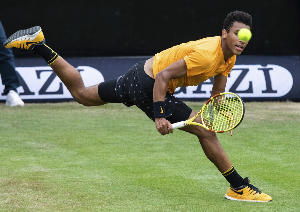 Felix Auger-Aliassime, of Canada, returns a shot to Dustin Brown of Germany, during the quarterfinals of the Stuttgart Open tennis tournament, Friday,