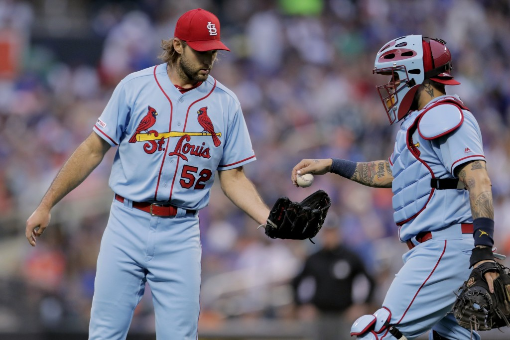 St. Louis Cardinals catcher Yadier Molina, right, gives the ball to starting pitcher Michael Wacha after Wacha surrendered a three-run home run to New...