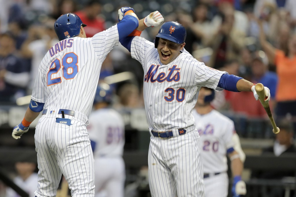 New York Mets' J.D. Davis (28) celebrates his solo home run off St. Louis Cardinals starting pitcher Michael Wacha with Michael Conforto (30) during t...