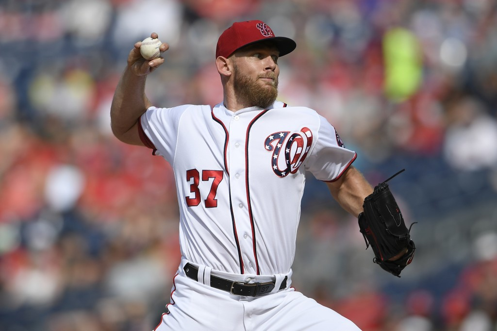 Washington Nationals starting pitcher Stephen Strasburg delivers a pitch during the third inning of a baseball game against the Arizona Diamondbacks,