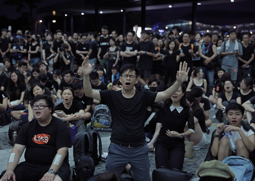 Protesters sing after a march against an extradition bill outside Legislative Council in Hong Kong on Sunday, June 16, 2019. Hong Kong residents Sunda...