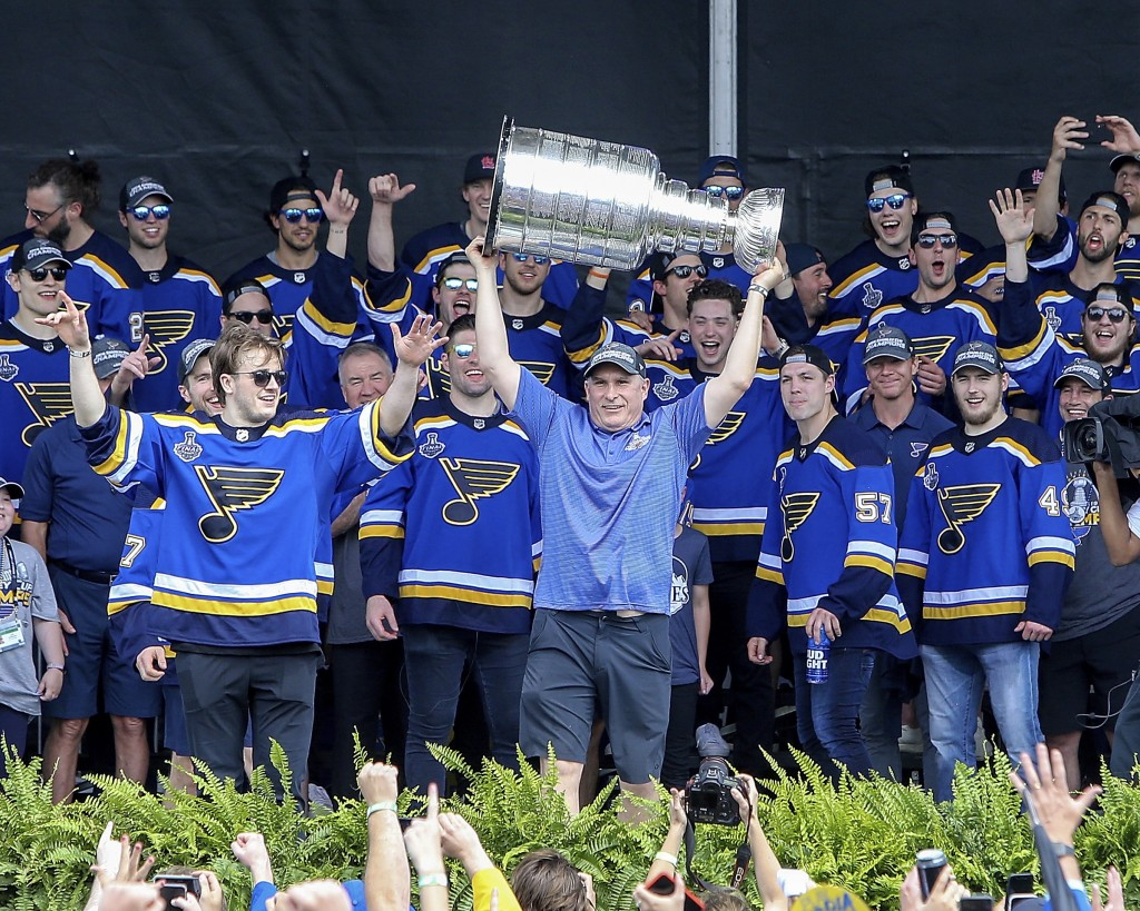 St. Louis Blues head coach Craig Berube holds the Stanley Cup overhead during the NHL hockey Stanley Cup victory celebration in St. Louis on Saturday,...