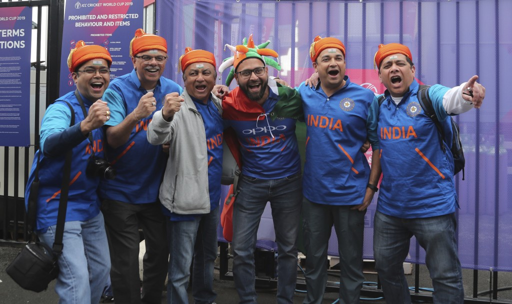 Indian fans cheer for their team before the start of the Cricket World Cup match between India and Pakistan outside Old Trafford in Manchester, Englan
