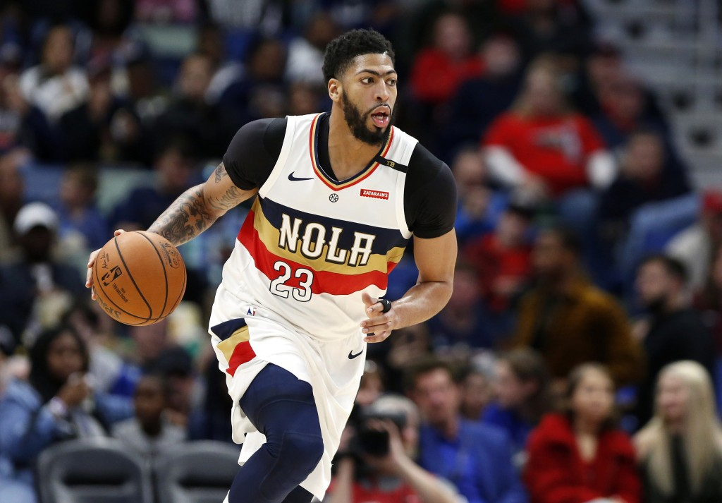 FILE - In this March 16, 2019, file photo, New Orleans Pelicans forward Anthony Davis brings the ball up during the first half of the team's NBA baske...
