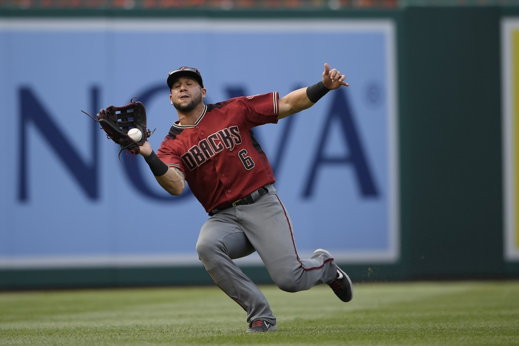 Arizona Diamondbacks left fielder David Peralta (6) catches a fly ball by Washington Nationals' Anthony Rendon for the out during the third inning of