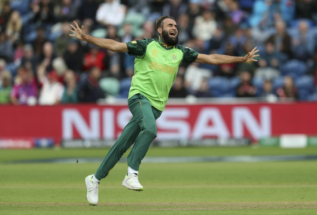 South Africa's Imran Tahir celebrates taking the wicket of Afghanistan's Noor Ali Zadran during the ICC Cricket World Cup group stage match at The Car...