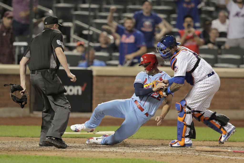 St. Louis Cardinals' Jack Flaherty, center, is tagged out by New York Mets catcher Wilson Ramos for the final out of a baseball game Saturday, June 15...